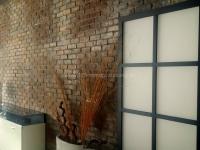 ladenbau-ziegelsteinwand-einrichtungshaus-geislingen-1