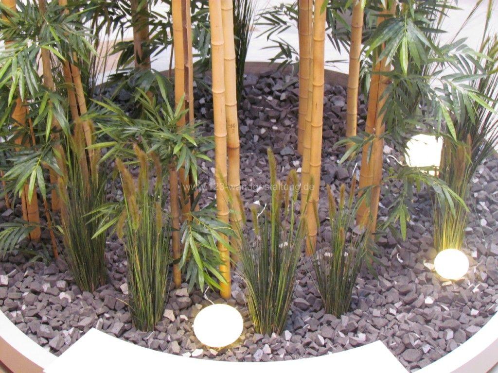 raumbegr nung mit kunstpflanzen f r ein frisches erscheinungsbild. Black Bedroom Furniture Sets. Home Design Ideas