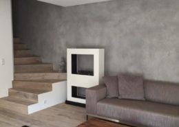 Wandgestaltung mit Farbputz von Trendzement in Betonoptik im Wohnzimmer